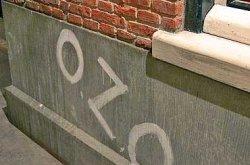 OZO op de muur gespoten: Oranje Zal Overwinnen