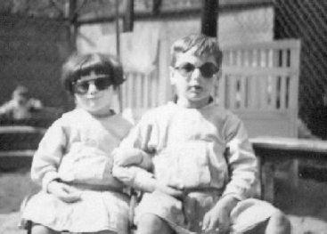 Two children wearing sun glasses.